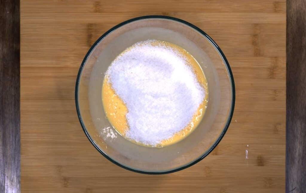 combine egg, milk, vanilla and desiccated coconut