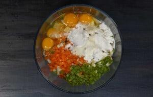 add the eggs carrots flour spring onion