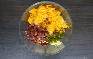 combine the mashed potato, cheese, bacon and parsley